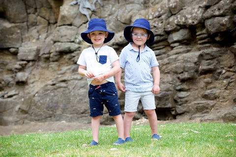 Two boys wearing Jordbarn Indigo Bucket Hats