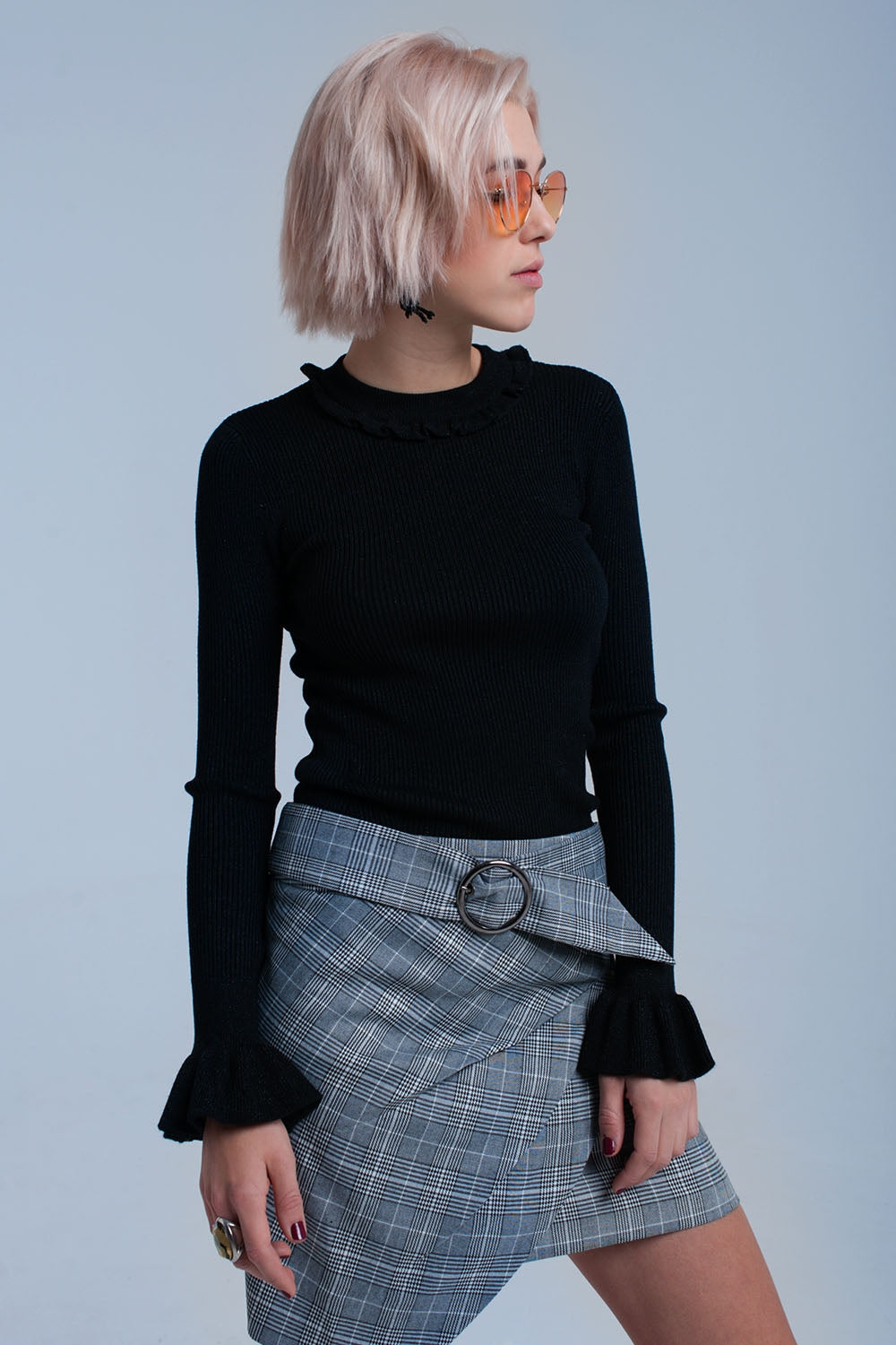 Black shiny sweater with ruffle