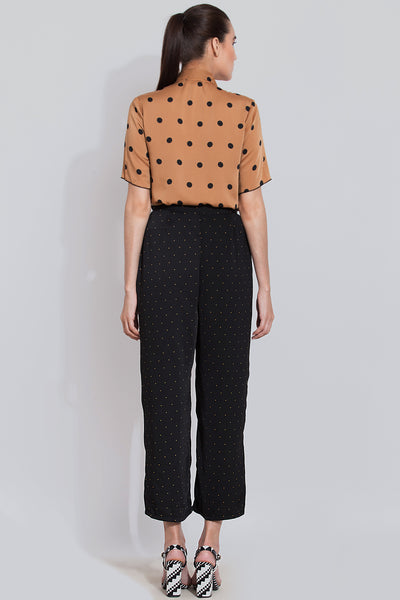 Black polka flared pants