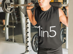 Man with a barbell on his shoulders wearing a 1 IN 5 Performance Tank