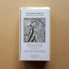 Load image into Gallery viewer, The white paper guidebook of the Smith-Waite Centennial Edition tarot deck.  Detail shows the deck is shrink wrapped.