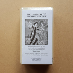 The white paper guidebook of the Smith-Waite Centennial Edition tarot deck.  Detail shows the deck is shrink wrapped.