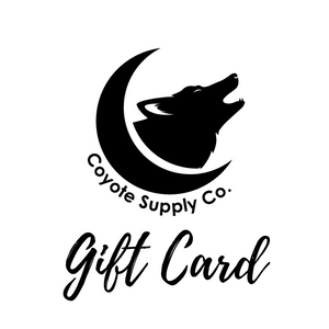 "Coyote Supply Co logo of a crescent moon cradling a howling coyote head and the words ""gift card"" in script below in black on a white background."