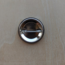 Load image into Gallery viewer, Detail of metal back of button with pin.