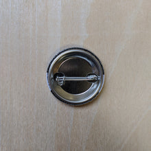 Load image into Gallery viewer, Back of metal button featuring a pin back.