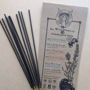 Sea Witch Botanicals kraft paper envelope next to 10 sticks of incense.
