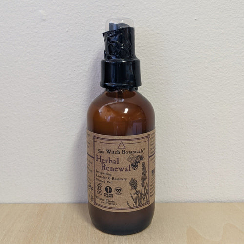 Amber glass bottle with kraft paper label and black plastic safety seal