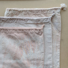 Load image into Gallery viewer, Three drawstring bulk bags, top to bottom: Desert Peach, Lavender, and Wild Rose