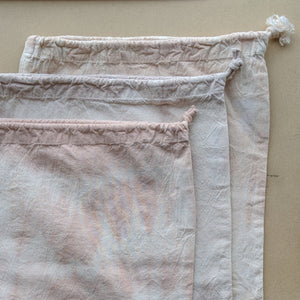 Three drawstring bulk bags, top to bottom: Desert Peach, Lavender, and Wild Rose