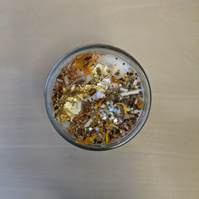 Load image into Gallery viewer, White soy wax candle topped with confetti, herbs including marigolds, and gold leaf.