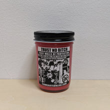 Load image into Gallery viewer, Red soy wax candle in glass jar with a black and white label.