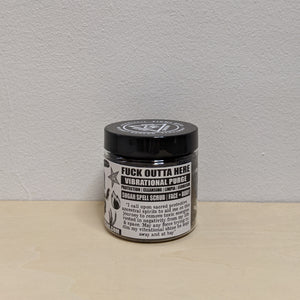 Black sugar scrub in plastic jar with black and white label.