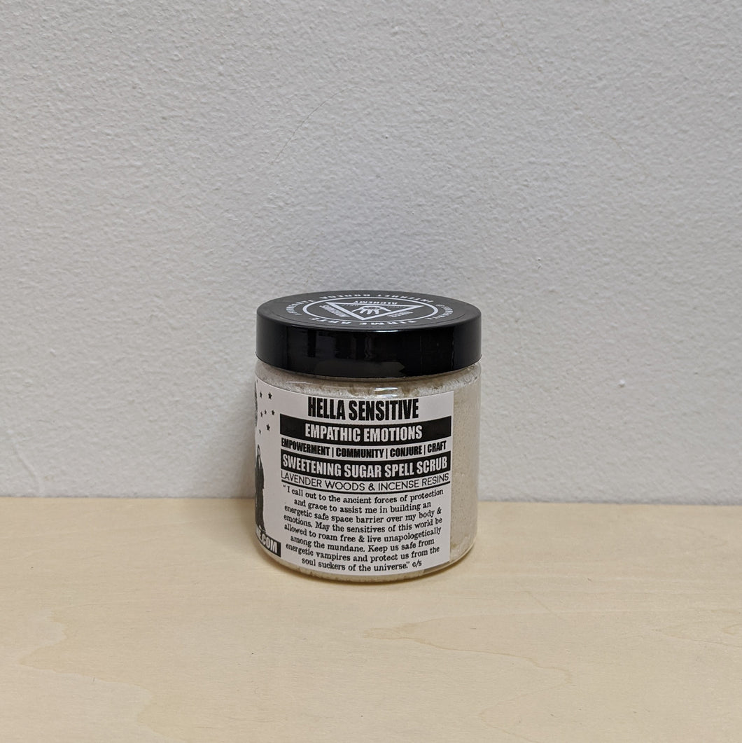 White sugar scrub in plastic jar with black & white label.