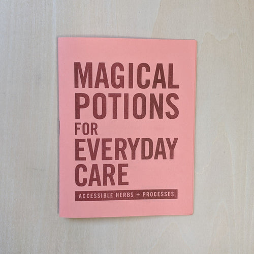 Burgundy ink on salmon paper reads: Magical Potions for Everyday Care Accessible Herbs + Processes