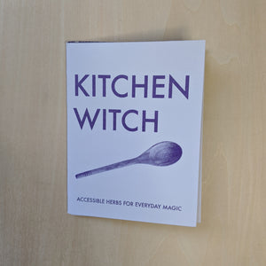 "Purple text on lavender paper reads ""Kitchen Witch Accessible Herbs for Everyday Magic"" and features a photo of a wooden spoon."