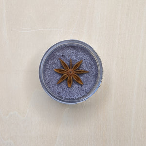 Steely purple sugar scrub with a star anise seed topper.