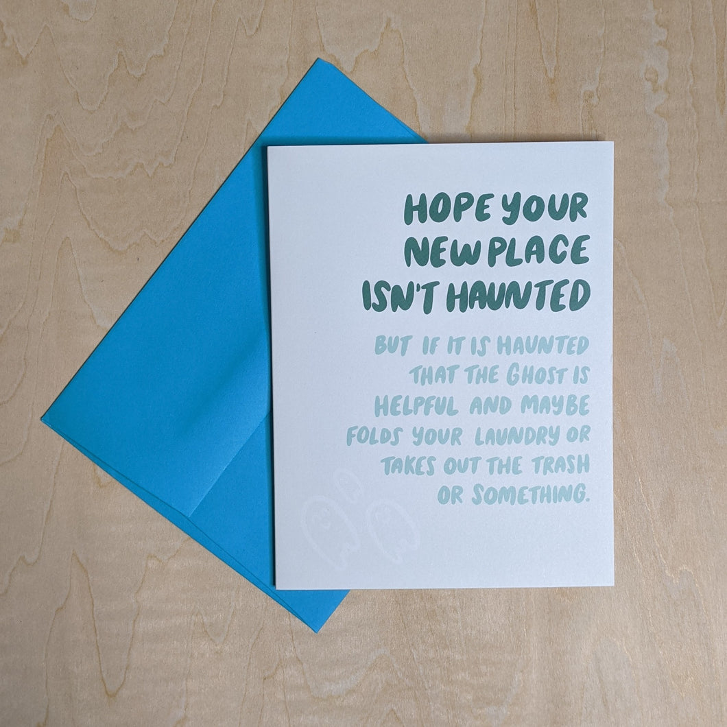 Teal envelope layered under a white card that reads