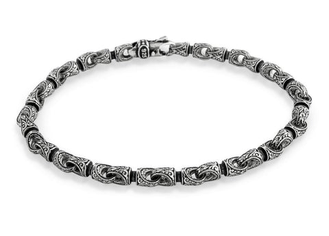 TWISTED BLADE SILVER BRACELET WITH INTRICATE ENGRAVED COUPLINGS