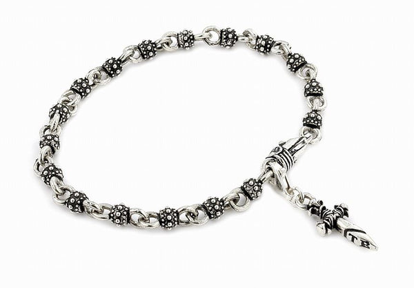 TWISTED BLADE SILVER STUDDED BALL LINK BRACELET WITH DAGGER CHARM