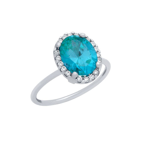 RHODIUM PLATED TOPAZ BLUE OVAL CZ RING WITH SURROUNDING CLEAR CZ STONES