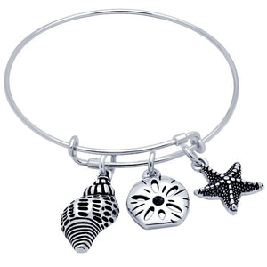 STERLING SILVER EXPANDABLE BANGLE WITH STARFISH AND SEASHELL CHARMS