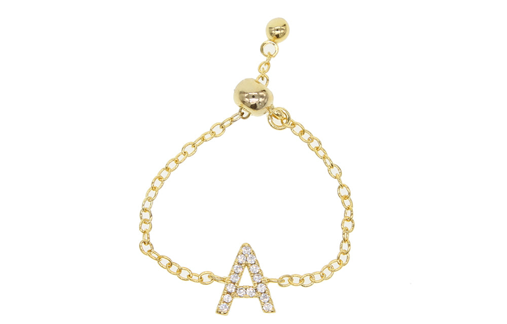 THE X CARTEL REASON TO BUY: These fun initial, alphabet chain rings are the sweetest little gift. Spoil someone special! METAL: Brass STONE: Cubic Zirconia