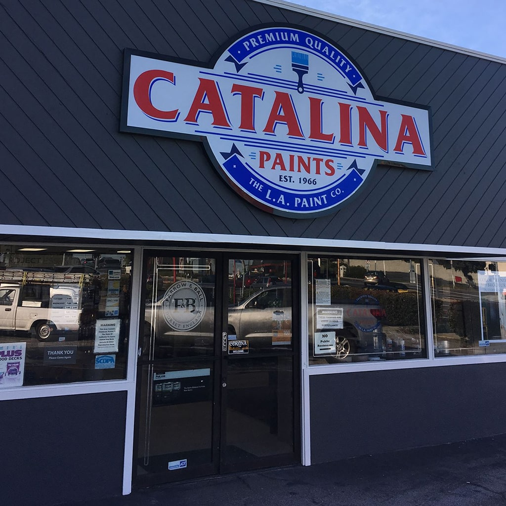 Catalina Paints store front; dark gray building with large Catalina Paints logo