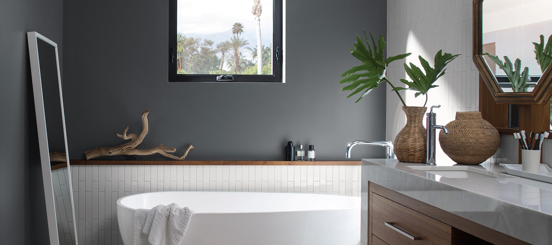 modern bathroom painted dark gray with white fixtures