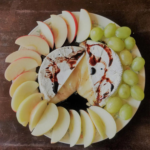 Baked Brie with grapes on tray