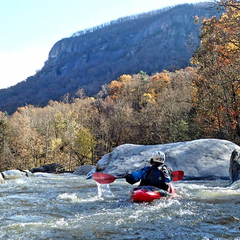 Gaia Herbs employee Dave Thomas on river kayaking
