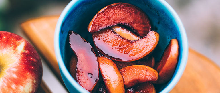 Elderberry Apple Cinnamon Compote in blue bowl