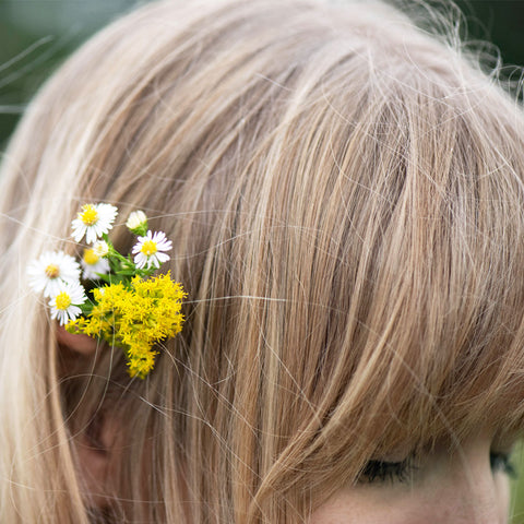 close up of woman's hair with flowers in it