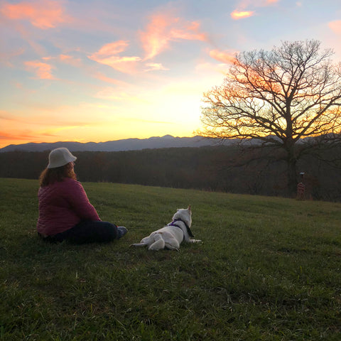 Gaia Herbs employee Jennifer Hoffman with her dog watching sunset