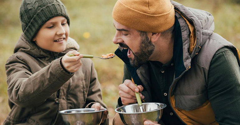 Father and son in nature, eating foods with prebiotics