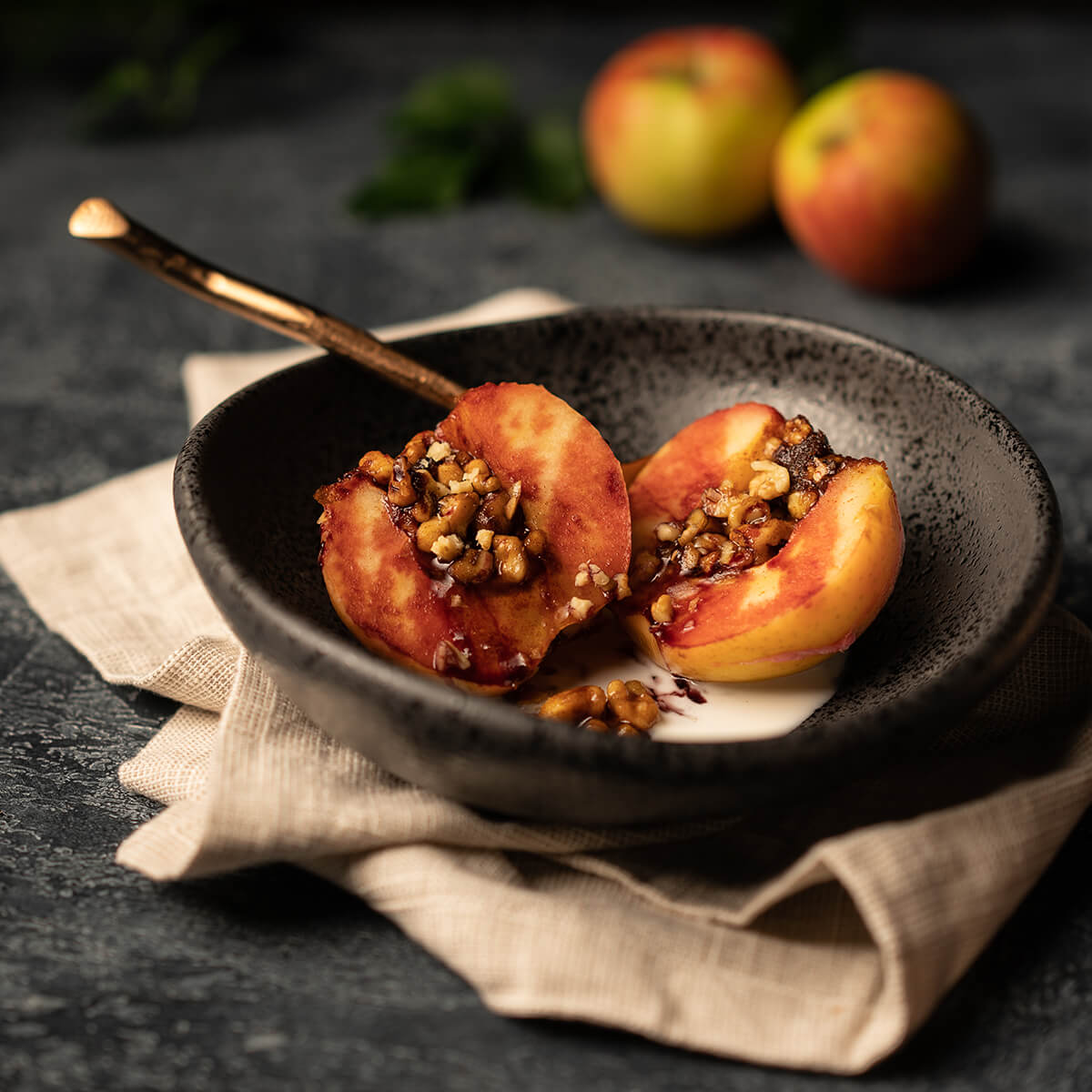 Baked Apples in a bowl covered with Gaia Herbs Black Elderberry Syrup