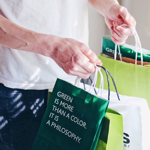 Man holding green shopping bags