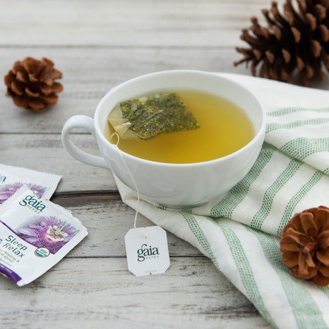Herbal holiday tea with gaia herbs tea packets on side