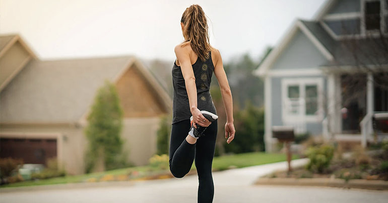 Woman stretching her leg before a workout