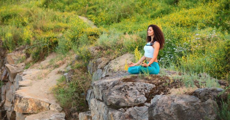 Woman doing yoga thinking about how to balance hormones