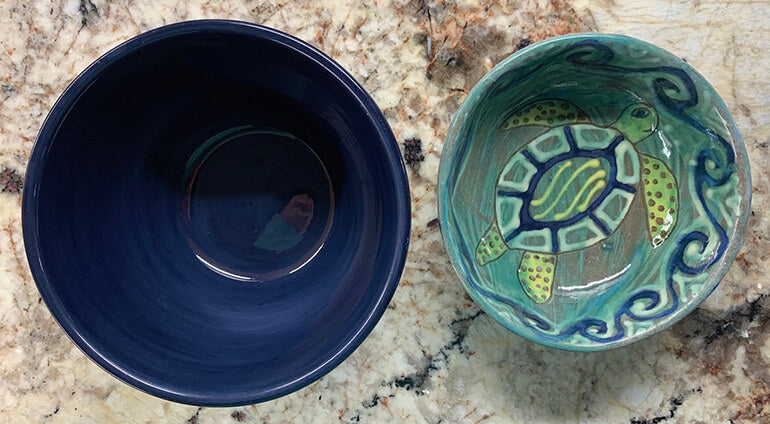 Two empty bowls on table