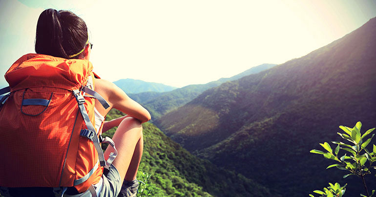 woman taking a rest from hiking for some mental clarity