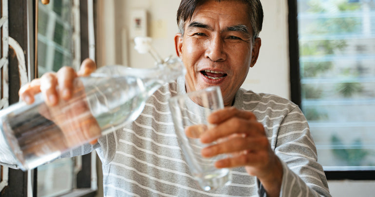 Man drinking water after taking saw palmetto for men