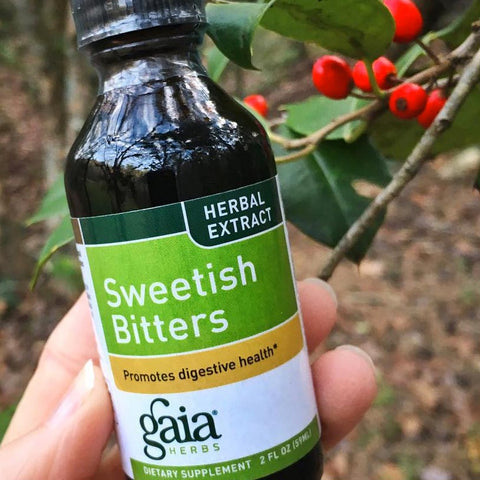sweetish bitters herbal extract in front of bitters on branch