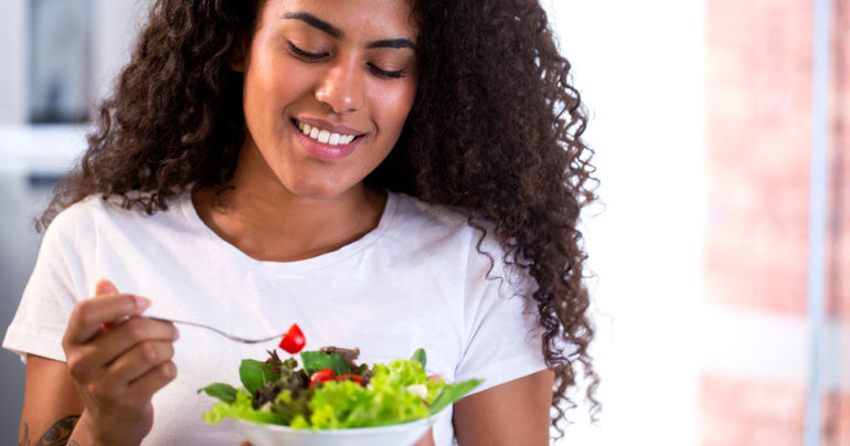 Woman eating a salad with turkey tail mushroom benefits