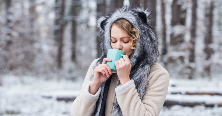 Woman drinking hot tea to help with weakened immune system
