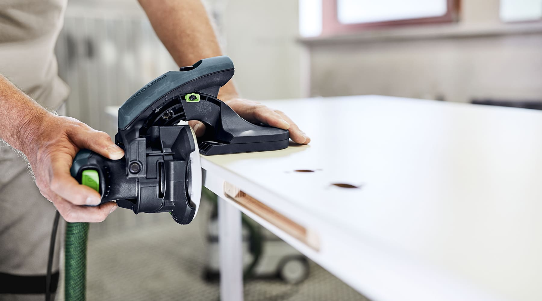 A man using Festool sander, available at JC Licht in Chicago, IL.