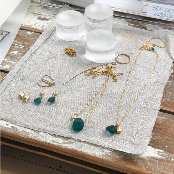 Icelandic teal seaglass and gold charm necklaces