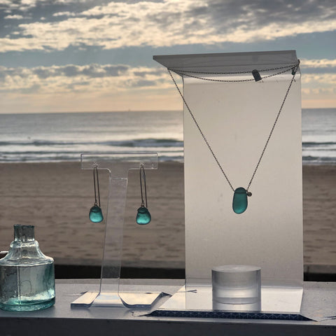 kriket broadhurst seaglass jewellery teal earrings and necklace on manly beach