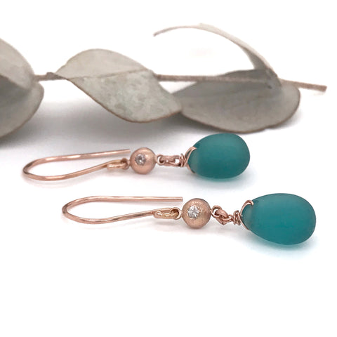 teal sea glass earrings on rose gold hooks with rose gold pebbles gem set with white sapphires Kriket Broadhurst jewellery Sydney