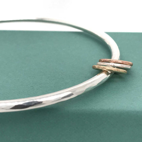 sterling silver chunky bangle with multi-coloured metal rings rose gold yellow gold kriket broadhurst jewellery Sydney